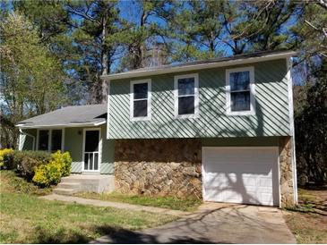 Photo one of 665 Old Manor Rd Nw Lilburn GA 30047 | MLS 6518199