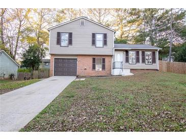 Photo one of 764 Old Manor Rd Nw Lilburn GA 30047 | MLS 6811607