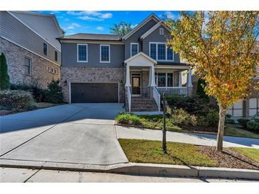 Photo one of 2616 Kentwood Ln Alpharetta GA 30009 | MLS 6824893