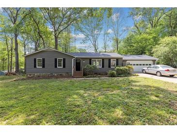 Photo one of 712 Talemwood Ct Lawrenceville GA 30044 | MLS 6877438