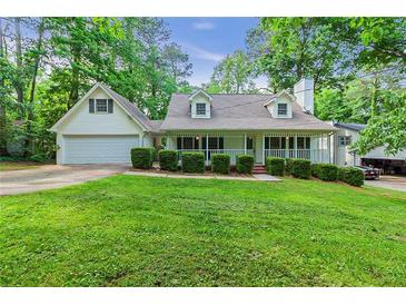 Photo one of 5884 Four Winds Dr Sw Lilburn GA 30047 | MLS 6877487