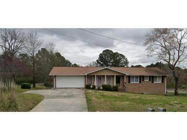 Photo one of 2498 Scenic Hwy S Snellville GA 30078 | MLS 6918013