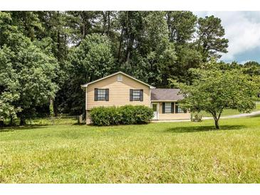 Photo one of 1171 Holly Hills Dr Sw Lilburn GA 30047   MLS 6918329