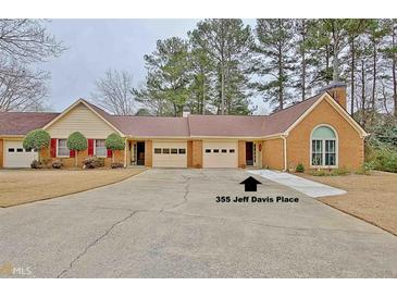 Photo one of 355 Jeff Davis Pl Fayetteville GA 30214 | MLS 8909805