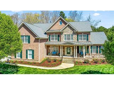 Photo one of 1021 Lake Forest Dr Matthews NC 28104 | MLS 3722402