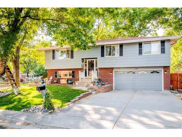 Photo one of 6987 Robb St Arvada CO 80004 | MLS 7720547