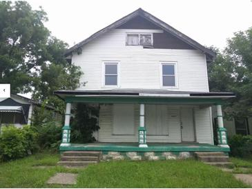 Photo one of 2425 N Olney St Indianapolis IN 46218 | MLS 21672921