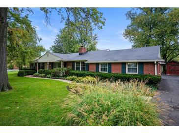 Photo one of 6417 Bramshaw Rd Indianapolis IN 46220 | MLS 21817447