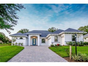Photo one of 38851 Harborwoods Pl Lady Lake FL 32159 | MLS O5907079
