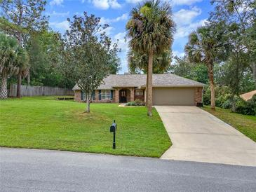 Photo one of 111 Pine Valley Ct Debary FL 32713 | MLS O5959323