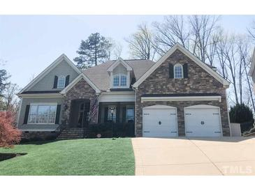 Photo one of 8111 Ortin Ln Raleigh NC 27612 | MLS 2375816