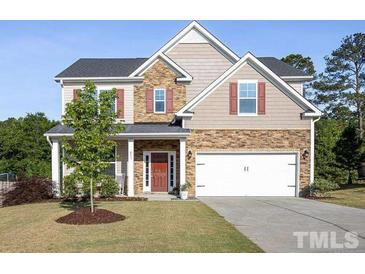 Photo one of 411 Pacific Heights Rd Knightdale NC 27545 | MLS 2387329