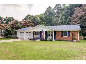 Photo one of 4225 Woodlawn Dr Raleigh NC 27616 | MLS 2396825