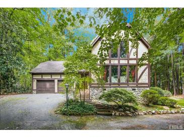 Photo one of 8841 Woodyhill Rd Raleigh NC 27613 | MLS 2405477