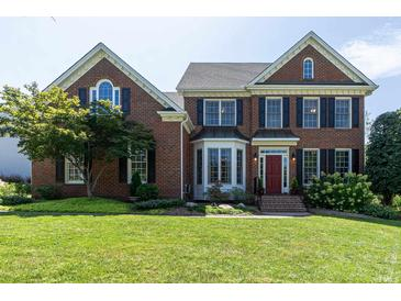 Photo one of 100 Parson Woods Ln Cary NC 27518 | MLS 2405670