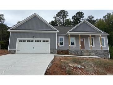 Photo one of 240 Alcock Ln Youngsville NC 27596 | MLS 2412168