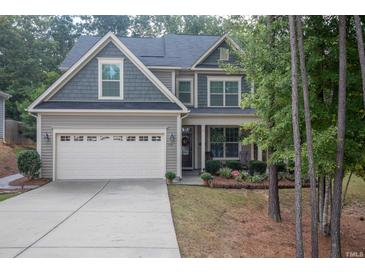 Photo one of 113 Ladys Mantle Ln Holly Springs NC 27540   MLS 2412180